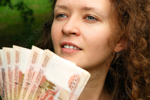 Young beautiful girl with money