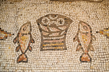 Ancient mosaic at The Church of the Loaves and Fish