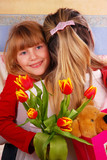 girl with bouquet of tulips for mummy poster
