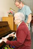 senior woman pensioner playing piano poster