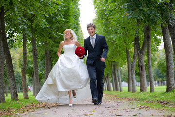 Just Married Couple Walking Fast Down The Path