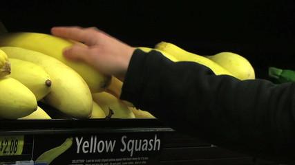 Woman Selecting Squash