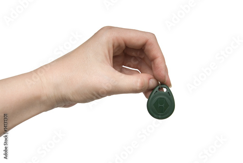 Woman hand with a green plastic door key