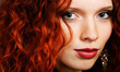 Close-up of beautiful woman face with red curly hair