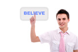 Young business man pressing the believe key poster