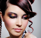 female face with multicoloured eyeshadow poster