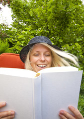 Woman enjoys reading a book