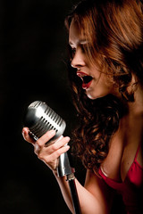 Beautiful singer singing with microphone
