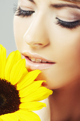 Beautiful woman with a sunflower