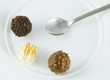3 truffles on white background IV