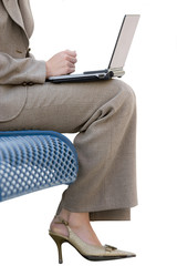 Businesswoman in suit sitting bench, low section, cut out
