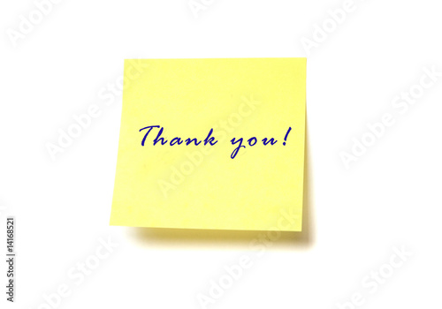 "Yellow post it with words ""Thank you"" isolated on white"