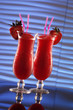 Strawberry daiquiri or smoothies on wavy blue