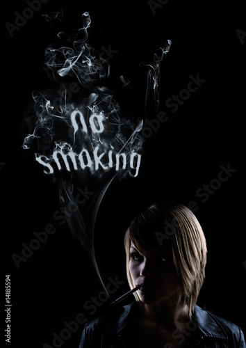 "young women smokes and in the smoke appears ""No Smoking"""