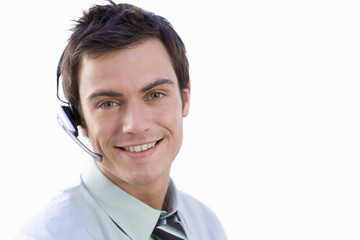 Man wearing headset, smiling, portrait, close-up, cut out