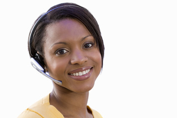Receptionist wearing headset, smiling, portrait, close-up, cut out