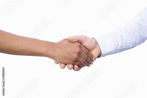 Businessman and woman shaking hands, close-up of hands, cut out