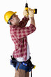 Builder wearing hardhat drilling, cut out