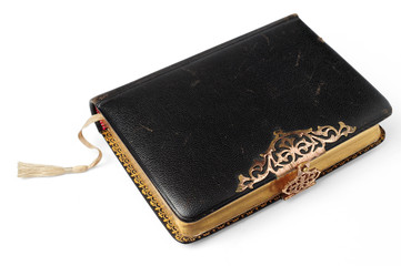 Old Bible isolated on a white background, with clipping path.