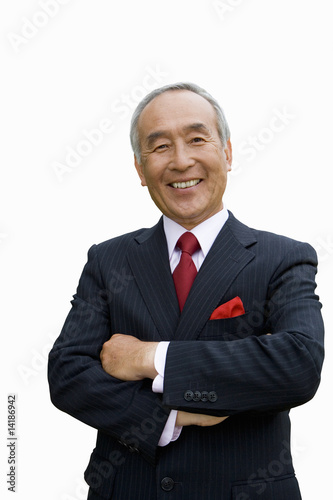 Mature businessman with arms crossed, portrait, cut out