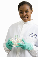 Female laboratory technician with test tubes, smiling, portrait, cut out