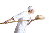 Female baker checking bread, side view, cut out