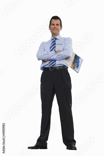 Car salesman holding brochure, smiling, portrait, cut out