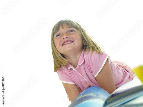 Girl with book, smiling, low angle view, cut out