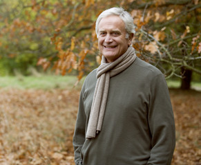 A portrait of a senior man in autumn time