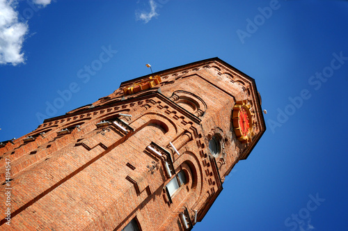 brick tower on a background blue sky