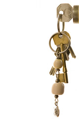 Keys on keying in lock, close-up, side view, cut out