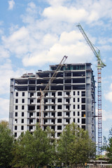Residential building construction with crane and sky