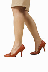 Woman in red stilettos, side view, surface level, cut out