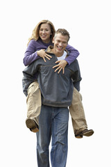 Man carrying woman by piggyback, smiling, front view, portrait, cut out
