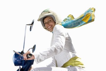 woman smiling on motorcycle, cut out