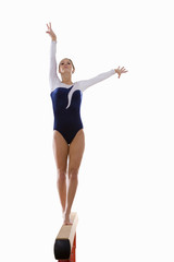 girl on balancing beam, cut out