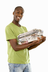 man holding pile of magazines, cut out