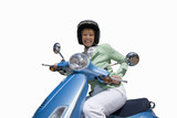 woman on scooter wearing helmet, cut out
