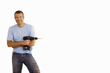 man with arms crossed holding drill, cut out
