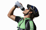 cyclist man drinking from bottle of water, cut out