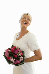 senior bride in wedding dress with bouquet, laughing, cut out
