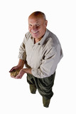 senior man looking up holding handful of grain, cut out