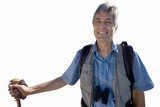 senior man with rucksack holding hiking stick, cut out