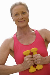 senior woman holding weights, cut out