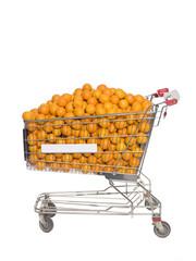 Shopping Cart with oranges isolated towards white background