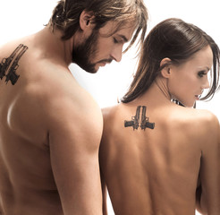 Beautiful couple turned away with tattoos on the back
