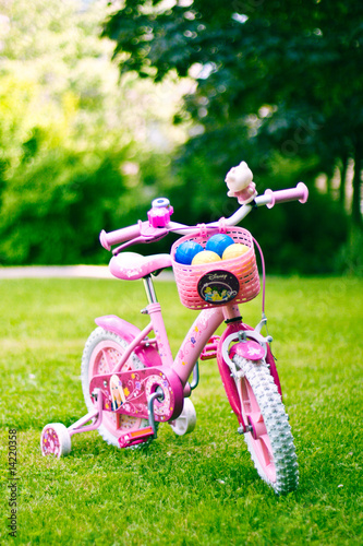 pink bike, green grass
