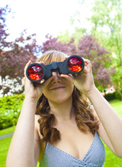 Looking through field glasses