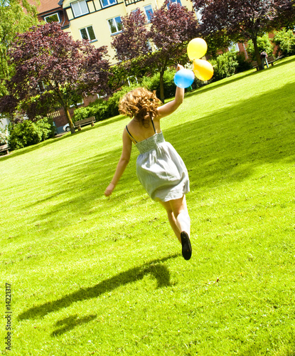 Running girl in a park