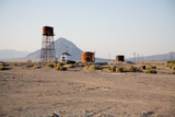 alter Wasserturm und alte Fabrikanlage, Death Valley Junction poster